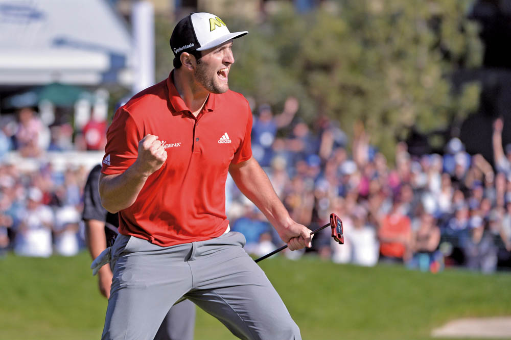 Jan 29, 2017; La Jolla, CA, USA; Jon Rahm celebrates after a eagle on the 18th hole during the final round of the Farmers Insurance Open golf tournament at Torrey Pines Municipal Golf Course - South Co. Mandatory Credit: Orlando Ramirez-USA TODAY Sports